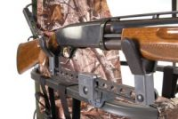 Right-handed or left handed gun holder for tree stand
